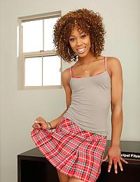 Black schoolgirl strips to bra