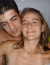 Hot Latina couple showering and self-shooting naked together