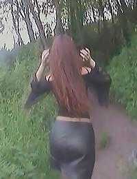 Leather skirt girl pisses outdoors