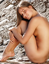 Dana C models outdoors in this photo set by FEMJOY.