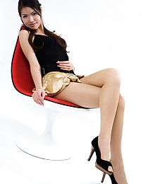 Asian Babe With Nice Legs Pos...