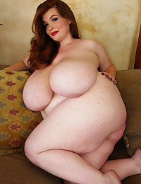 Redhead with gigantic BBW boobs