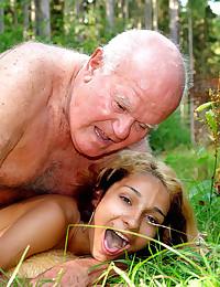 Grandpa bangs a skinny teen girl in a forest