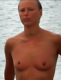 Naked shaved girl at beach