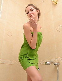 Lesya is looking hot as hell in her green bikini.