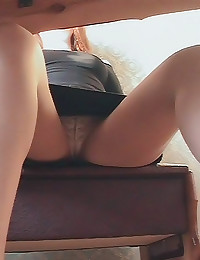 Upskirt of leather skirt girl