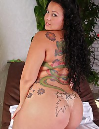 Back tattoo on curvy Brazilian