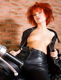 Tattooed biker babe in leathe...