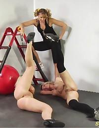 Two exercising and masturbating gym slaves