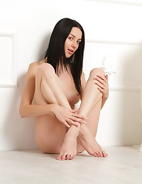 Olga E strips and shows her hot body for your entertainment.