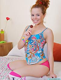 Teen sucks a lollipop