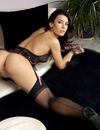 Her black lingerie is a beautiful thing and it dominates the erotic gallery.