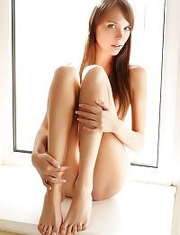 She models sexy fishnet stock...