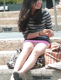 Very hot brunette in mini, up skirts sitting