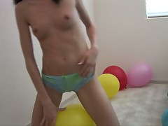 Pigtailed hottie enjoys riding her yellow balloon