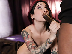 Joanna sucks on a big black cock after stripping on a pole.