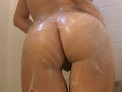 Chrissy gets wet in the shower