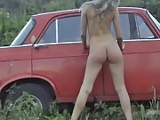 Old russian car and pussy posing