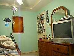 Teen caught changing after shower on hidden cam