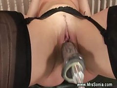 Old slut gets inserted by dildo machine