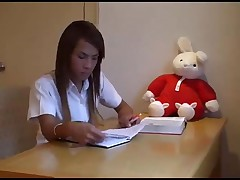 Asian teen ladyboy in school uniform
