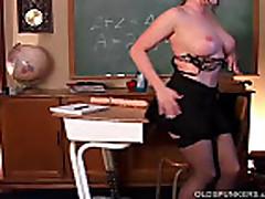 Sexy MILF in stockings fucks huge dildo