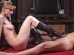 kicking out the cum with her boots