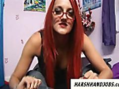 Hot redhead with glasses gives harsh handjob