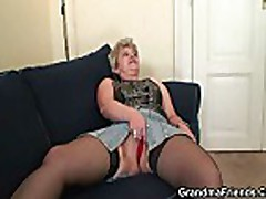 Nasty granny is taking in two cocks